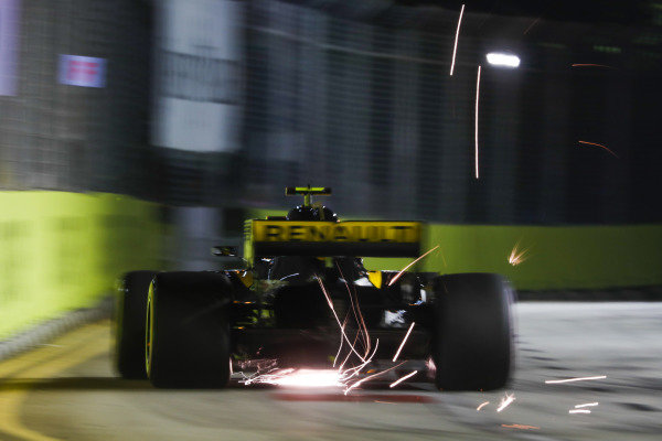 Sparks fly from the rear of Carlos Sainz Jr., Renault Sport F1 Team R.S. 18.