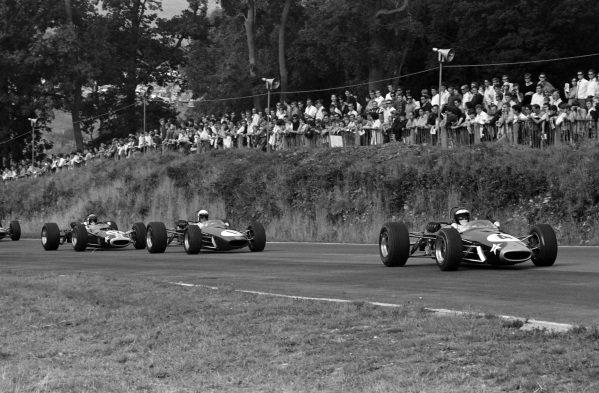 Jochen Rindt, Brabham BT23 Ford, leads Jack Brabham, Brabham BT23 Ford, and Jackie Stewart, Matra MS7 Ford.