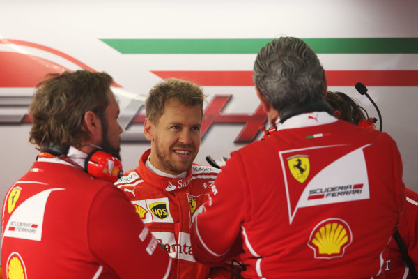 Shanghai International Circuit, Shanghai, China.  Friday 07 April 2017. Sebastian Vettel, Ferrari, talks to colleagues including Maurizio Arrivabene, Team Principal, Ferrari.  World Copyright: LAT Images ref: Digital Image AN7T3438