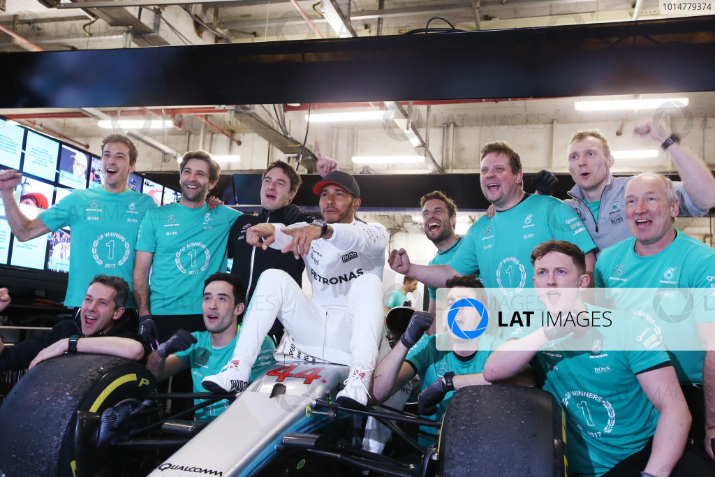 Shanghai International Circuit, Shanghai, China.  Sunday 09 April 2017.  Lewis Hamilton, Mercedes AMG, celebrates victory with colleagues astride his car. World Copyright: Charles Coates/LAT Images  ref: Digital Image AN7T1008