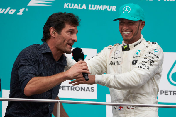 Sepang International Circuit, Sepang, Malaysia. Sunday 1 October 2017. Mark Webber, TV Pundit, Channel 4 F1, interviews Lewis Hamilton, Mercedes AMG, 2nd Position, on the podium. World Copyright: Steve Etherington/LAT Images  ref: Digital Image SNE11934