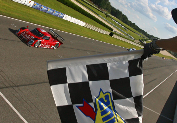 17-19 July, 2009, Birmingham, Alabama USA The Pontiac Riley of Alex Gurney and Jon Fogarty takes the checkered flag to win the Porsche 250.©2009, R. D. Ethan, USA LAT Photographic