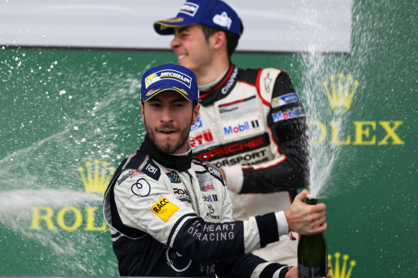 Race winner Alex Riberas (ESP) Lechner Racing Team Seattle celebrates on the podium with the champagne at Porsche Supercup, Rd8, Austin, Texas, USA, 23-25 October 2015.
