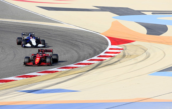 Charles Leclerc, Ferrari SF21, leads George Russell, Williams FW43B