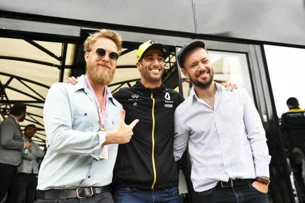 Ted Dwane and Marcus Mumford of the band Mumford and Sons meet Daniel Ricciardo, Renault F1 Team