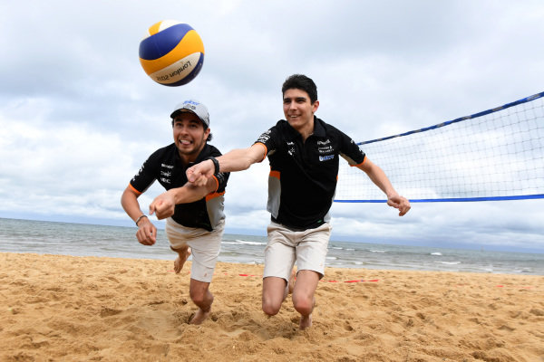 Sergio Perez (MEX) Force India and Esteban Ocon (FRA) Force India F1 play Beach Volleyball at Formula One World Championship, Rd1, Australian Grand Prix, Preparations, Albert Park, Melbourne, Australia, Wednesday 22 March 2017. BEST IMAGE