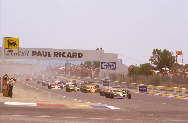 Paul Ricard, France.3-5  July 1987.Nigel Mansell (Williams FW11B Honda) leads Alain Prost (McLaren MP4/3 TAG Porsche), Nelson Piquet (Williams FW11B Honda) and Ayrton Senna (Lotus 99T Honda) at the start. Ref-87 FRA 13.World Copyright - LAT Photographic