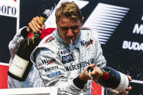 Mika Häkkinen, 1st position, celebrates on the podium.