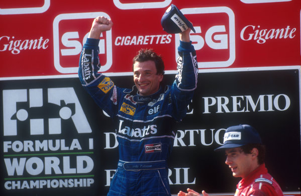 1991 Portuguese Grand Prix.Estoril, Portugal.20-22 September 1991.Riccardo Patrese (Williams Renault) celebrates 1st position on the podium. Ayrton Senna (McLaren Honda) 2nd position stands next to him.Ref-91 POR 06.World Copyright - LAT Photographic