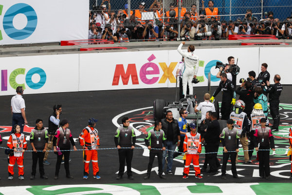 Lewis Hamilton, Mercedes AMG F1, celebrates in Parc Ferme after securing his 5th world drivers championship title