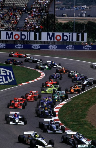 The pack head through the first corner. Circuit de Catalunya, Spain, 5 May 2000. World - LAT Photographic