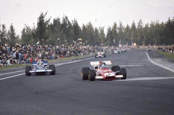 Jacky Ickx, Ferrari 312B, 1st, leads Jackie Stewart, Tyrrell 001 Ford, retired.