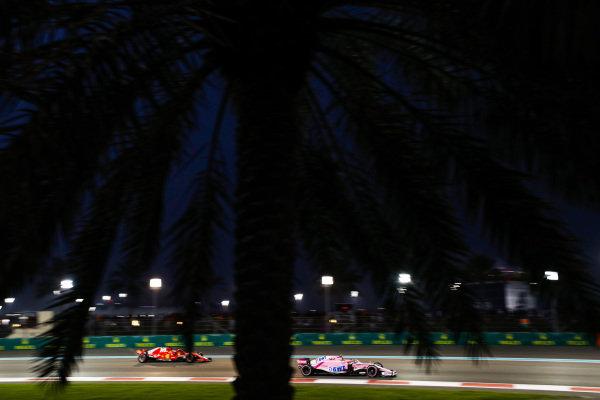 Esteban Ocon, Racing Point Force India VJM11, leads Sebastian Vettel, Ferrari SF71H
