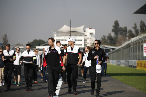 Andre Lotterer (DEU), Tag Heuer Porsche and Neel Jani (CHE), Tag Heuer Porsche walk the track with members of their team
