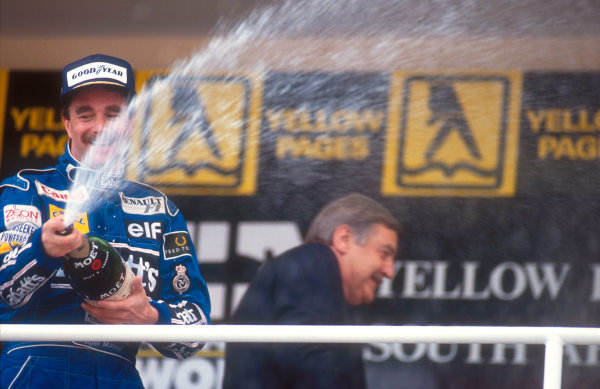 1992 South African Grand Prix.Kyalami, South Africa.28/2-1/3 1992.Nigel Mansell (Williams Renault) celebrates 1st position on the podium.Ref-92 SA 07.World Copyright - LAT Photographic