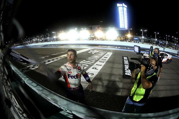 Race winner Denny Hamlin, Joe Gibbs Racing Toyota, Copyright: Michael Reaves/Getty Images.