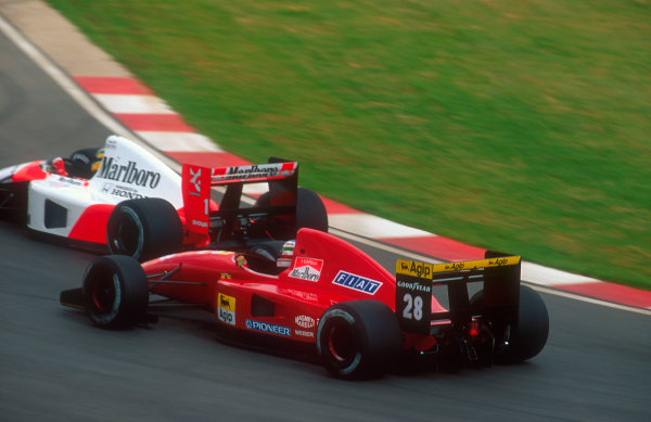 1992 South African Grand Prix.Kyalami, South Africa.28/2-1/3 1992.Ivan Capelli (Ferrari F92A) battles with Ayrton Senna (McLaren MP4/6B Honda).Ref-92 SA 08.World Copyright - LAT Photographic