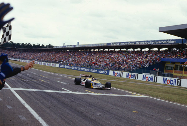 1987 German Grand Prix.Hockenheim, Germany.24-26 July 1987.Nelson Piquet (Williams FW11B Honda) takes the chequered flag for 1st position.Ref-87 GER 22.World Copyright - LAT Photographic