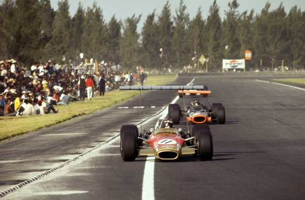 Jackie Oliver (GBR) in a Lotus Cosworth 49B battles for third place with local hero Pedro Rodriguez (MEX) in a BRM P133.