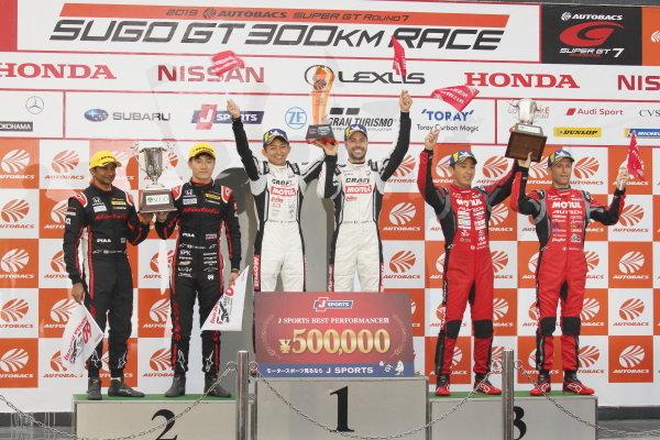 Round 7 GT500 Winner Kohei Hirate & Frederic Makowiecki, Craftsports Motul NDDP Racing with B-Max Nissan GT-R NISMO, celebrate on the podium. Alongside are 2nd position Narain Karthikeyan &  Tadasuke Makino, Modulo Nakajima Epson Honda NSX-GT and 3rd position Tsugio Matsuda & Ronnie Quintarelli,  Motul Autech NISMO Nissan GT-R.