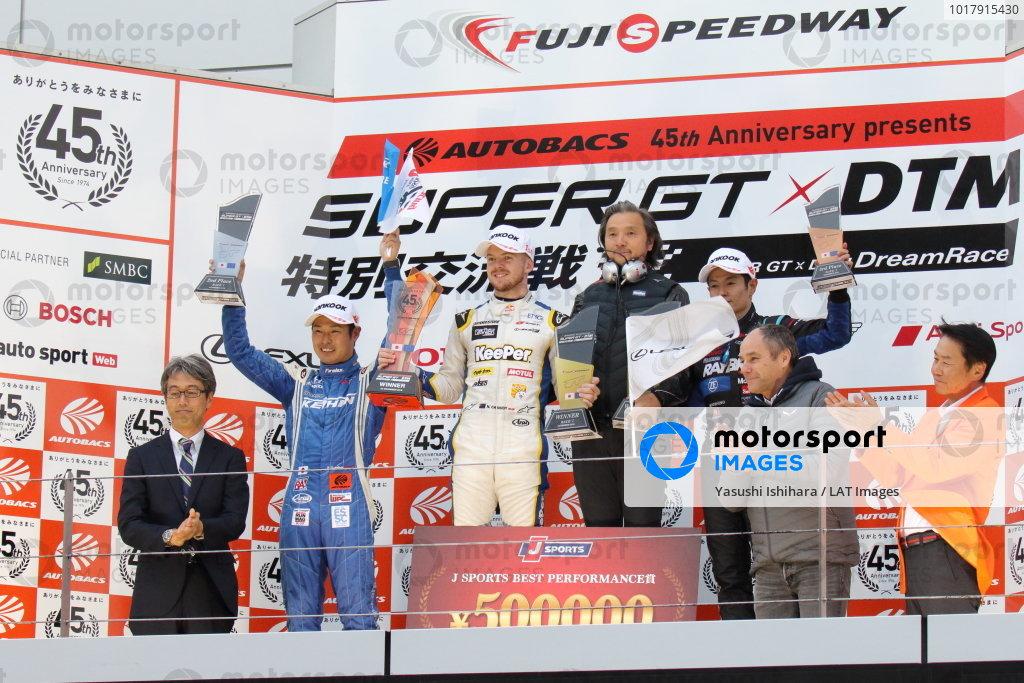 Super GT - DTM Dream Race. The race one podium. Winner Nick Cassidy Lexus Team KeePer TOM's, Lexus LC 500 GT500, stands above Koudai Tsukakoshi, Keihin Real Racing, Honda NSX-GT, 2nd position and Naoki Yamamoto, Raybrig Team Kunimitsu, Honda NSX-GT, 3rd