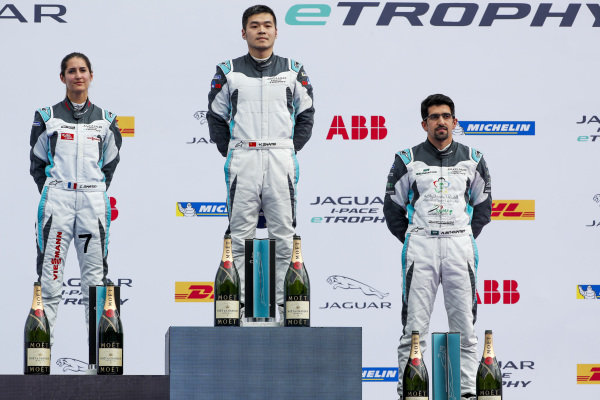 Yaqi Zhang (CHI), Team China, 1st position, Célia Martin (FRA), Viessman Jaguar eTROPHY Team Germany, 2nd position, and Ahmed Bin Khanen (SAU), Saudi Racing, 3rd position, celebrate on the podium