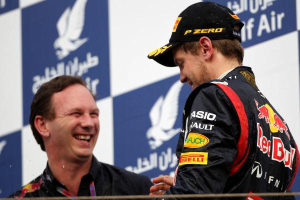 Bahrain International Circuit, Sakhir, Bahrain22nd April 2012Christian Horner, Team Principal, Red Bull Racing, and Sebastian Vettel, Red Bull Racing, 1st position, celebrate on the podium. World Copyright: Andy Hone/LAT Photographicref: Digital Image HONY8730