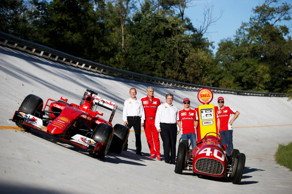 Autodromo Nazionale di Monza, Monza, Italy. Saturday 5 September 2015. Shell announce their renewed partnership with Ferrari on the Monza banking with Sebastian Vettel, Ferrari, John Abbott, Downstream Director, Shell, Mauricio Arrivabene, Team Principal, Ferrari, Istvan Kapitany, Executive Vice President of Retail, Shell and Kimi Raikkonen, Ferrari, alongside a Ferrari SF-15T and a Ferrari 166 F2 car. World Copyright: Glenn Dunbar/LAT Photographic ref: Digital Image _89P7806