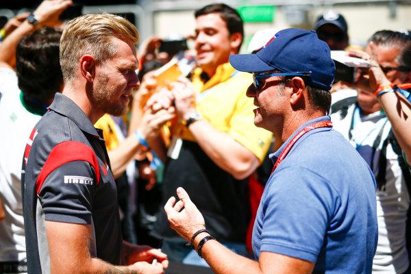 Interlagos, Sao Paulo, Brazil. Sunday 12 November 2017. Kevin Magnussen, Haas F1, with Rubens Barrichello. World Copyright: Andy Hone/LAT Images  ref: Digital Image _ONZ5596