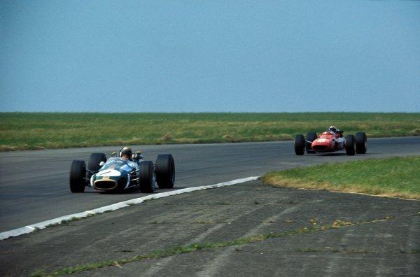 Jack Brabham (AUS) Brabham Repco BT24, leads Chris Amon (NZL) Ferrari 312. Formula One World Championship, Rd6, British Grand Prix, Silverstone, England. 15 July 1967. BEST IMAGE