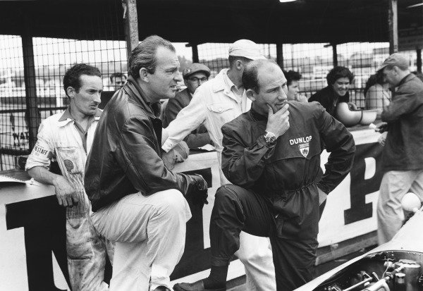 Aintree, Great Britain. 18th July 1959.Stirling Moss (BRM P25), 2nd position and Harry Schell (BRM P25), 4th position, chat in the pits, portrait.World Copyright: LAT Photographic.Ref: 8333C - 12.