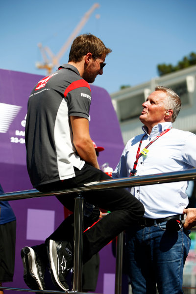Baku City Circuit, Baku, Azerbaijan. Sunday 25 June 2017. Romain Grosjean, Haas F1, talks to Johnny Herbert. World Copyright: Andy Hone/LAT Images ref: Digital Image _ONZ8164