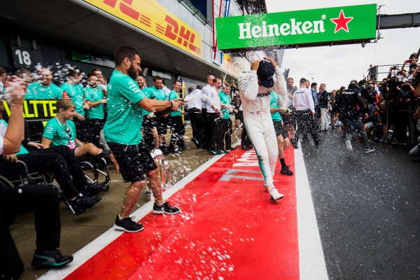 Silverstone, Northamptonshire, UK.  Sunday 16 July 2017. Lewis Hamilton, Mercedes AMG, 1st Position, and Valtteri Bottas, Mercedes AMG, 2nd Position, celebrate with their team and guests. World Copyright: Mauger/LAT Images  ref: Digital Image _56I1668