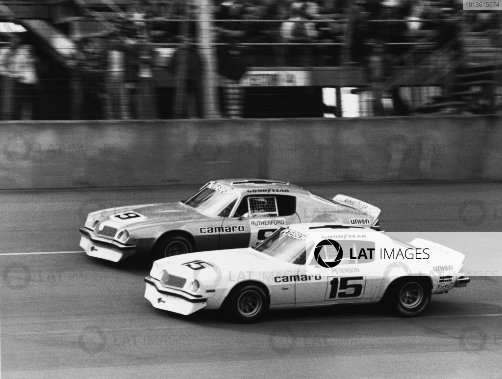 Daytona, Florida, USA. 14th February 1975. Rd 4.Ronnie Peterson and Johnny Rutherford (Chevrolet) both retired in the final round of the championship, action. World Copyright: LAT Photographic.Ref:  B/W Print.