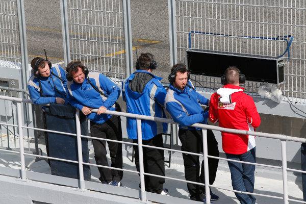 2014 GP3 Series Test 1. Estoril, Portugal.  Thursday 19 March 2015. Carlin team look down the pit lane Photo: Sam Bloxham/GP3 Series Media Service. ref: Digital Image _SBL0769
