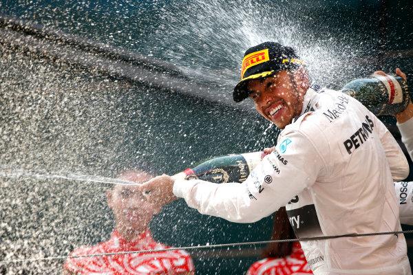 Shanghai International Circuit, Shanghai, China. Sunday 12 April 2015. Lewis Hamilton, Mercedes AMG, 1st Position, sprays the victory Champagne. World Copyright: Andrew Hone/LAT Photographic. ref: Digital Image _ONZ1282