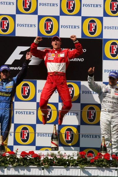 Race winner Michael Schumacher (GER) Ferrari on the podium.