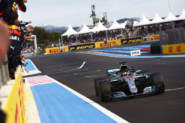 Lewis Hamilton, Mercedes AMG F1 W09, crosses the line to win the race.