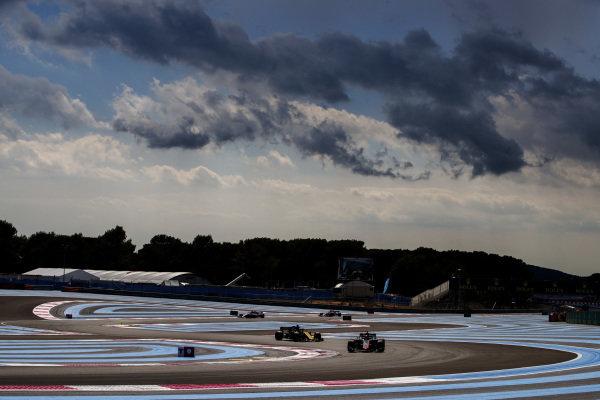 Romain Grosjean, Haas F1 Team VF-18 Ferrari, leads Nico Hulkenberg, Renault Sport F1 Team R.S. 18.