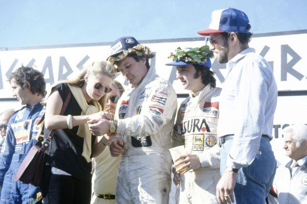 1981 Las Vegas Grand Prix.Caesar's Palace, Las Vegas, Nevada, USA. 15-17 October 1981.Alan Jones (Williams FW07C-Ford Cosworth), 1st position, Alain Prost (Renault RE30), 2nd position and Bruno Giacomelli (Alfa Romeo 179C), 3rd position on the podium.World Copyright: LAT PhotographicRef: 35mm transparency 81LV06