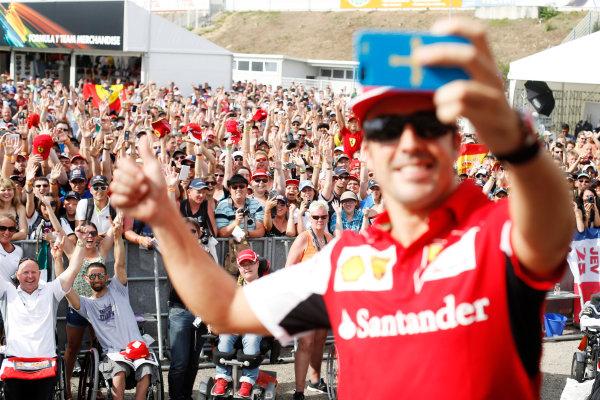 Hockenheimring, Hockenheim, Germany. Saturday 19 July 2014. Fernando Alonso, Ferrari, takes a picture of himself with the crowd. World Copyright: Charles Coates/LAT Photographic. ref: Digital Image _J5R4485