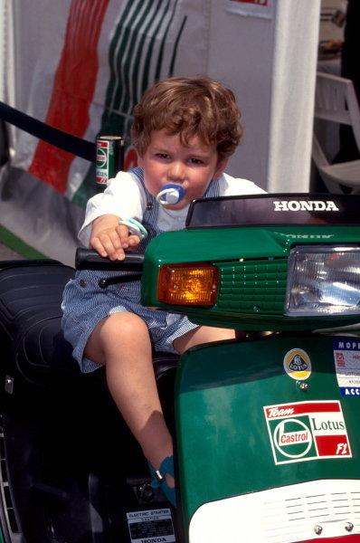 Joshua Hill (GBR) son of 1992 World Champion Damon Hill tries the Lotus scooter. German Grand Prix, Hockenheim, Germany, 25 July 1993