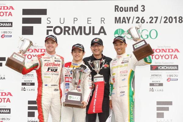 Race winner Naoki Yamamoto, number 16 Team Mugen SF14 Honda, celebrates on the podium alongside second place Nick Cassidy, number three ORIENTALBIO KONDO SF14 Toyota and third position Kazuki Nakajima, number 36 VANTELIN KOWA TOM'S SF14 Toyota.