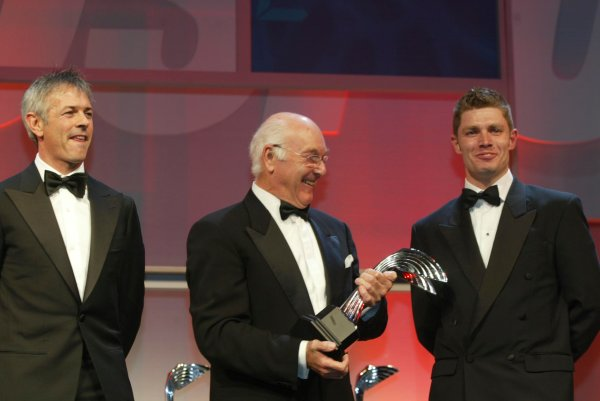 2003 AUTOSPORT AWARDS, The Grosvenor, London. 7th December 2003.Murray Walker hands out the Award for best Racing car to the Bentley Speed 8 which is collected by drivers Guy Smith and Rinaldo Capello.Photo: Peter Spinney/LAT PhotographicRef: Digital Image only