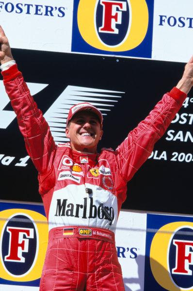 2004 San Marino Grand Prix.Imola, Italy23rd - 25th April 2004Michael Schumacher, Ferrari F2004 celebrates his win on the podium.World Copyright:Lorenzo Bellanca/LAT Photographic Ref: 35mm Image A52