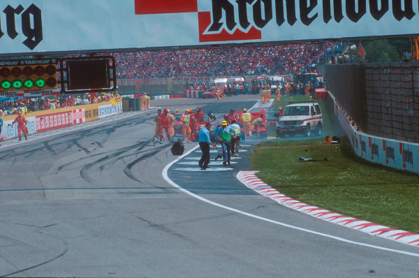 Imola, Italy.29/4-1/5 1994.Marshalls and track officials clear up after the Lehto/Lamy startline shunt.Ref-94 SM 14.World Copyright - LAT Photographic