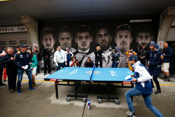 Shanghai International Circuit, Shanghai, China.  Sunday 09 April 2017. Felipe Massa, Williams Martini Racing, Daniel Ricciardo, Red Bull Racing, Max Verstappen, Red Bull and a local expert participate in a game to table tennis. Sky F1's Johnny Herbert watches the action. World Copyright: Andy Hone/LAT Images ref: Digital Image _ONY5439