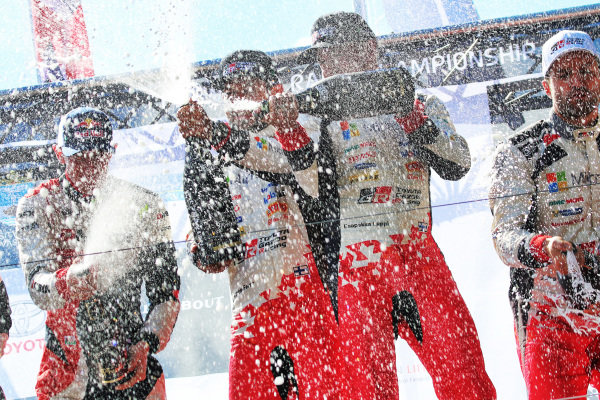 Second placed Elfyn Evans (GBR) / Daniel Barritt (GBR), M-Sport World Rally Team WRC, rally winners Esapekka Lappi (FIN) / Janne Ferm (FIN), Toyota Gazoo Racing WRT WRC and third placed Juho Hanninen (FIN) / Kaj Lindstrom (FIN), Toyota Gazoo Racing WRC celebrate on the podium with the champagne at World Rally Championship, Rd9, Rally Finland, Day Three, Jyvaskyla, Finland, 30 July 2017.