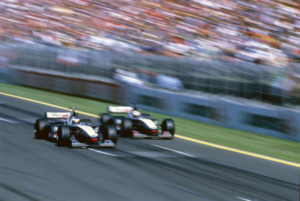 Albert Park, Melbourne, Australia. 6-8 March 1998.Mika Hakkinen passes David Coulthard (both McLaren MP4/13-Mercedes-Benz) for the lead. They finished in 1st and 2nd position respectively.World Copyright: LAT PhotographicRef: 98AUS27 A Race Through Time exhibition #93
