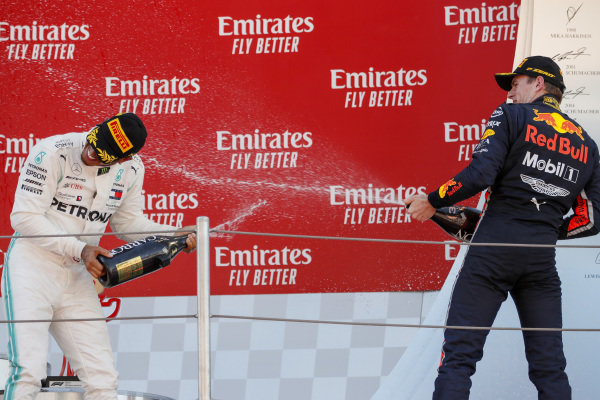 Race winner Lewis Hamilton, Mercedes AMG F1 and Max Verstappen, Red Bull Racing celebrate on the podium with the champagne